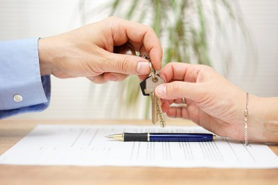 Real Estate Agent Gives House Keys To His Client After Signing C